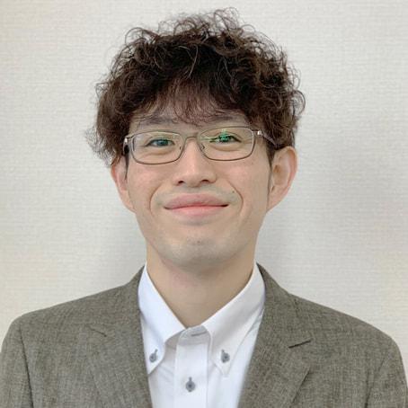 安田店長の笑顔